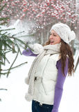 Winter woman behind snow tree Stock Photography