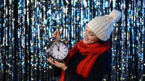 Winter woman with big alarm clock stock video footage