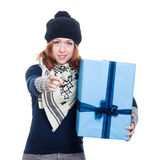 Winter woman with big present pointing Royalty Free Stock Images