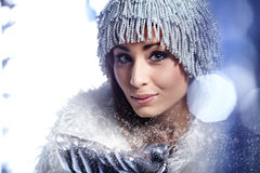 Winter woman Blowing Snow Royalty Free Stock Image