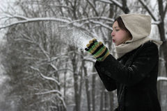 Winter woman blowing a snow Royalty Free Stock Photos