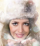 Winter woman Blowing Snow. Christmas Girl. Royalty Free Stock Images