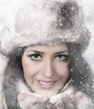 Winter woman Blowing Snow. Christmas Girl. Stock Photography