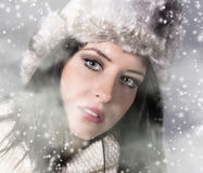 Winter woman Blowing Snow. Christmas Girl. Royalty Free Stock Image
