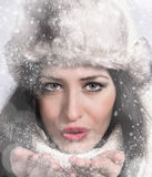 Winter woman Blowing Snow. Christmas Girl. Stock Images