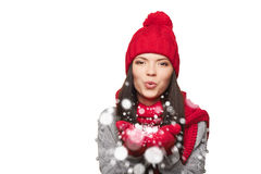 Winter woman blowing snow Stock Images