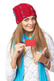 Winter woman with credit card showing thumb up Royalty Free Stock Photo