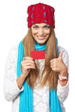 Winter woman with credit card showing thumb up Stock Photography