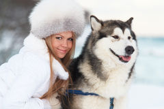 Winter woman with dog Royalty Free Stock Images