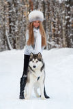 Winter woman with dog Stock Image