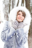 Winter woman dreaming. Winter woman  in white furs looking up Royalty Free Stock Photo