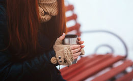 Winter. Woman drinking hot tea or coffee with iron insulated cup.  Royalty Free Stock Photo
