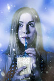 Winter woman drinking ice cold drink Royalty Free Stock Photo