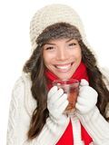 Winter woman drinking tea. Wearing warm winter clothing, sweater, gloves and scarf. Beautiful mixed race asian caucasian girl model isolated on white background Stock Image