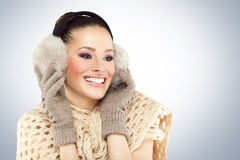 Winter woman with ear muff Stock Images