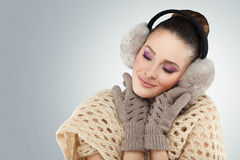 Winter woman with ear muff Royalty Free Stock Images