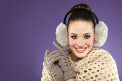Winter woman with ear muff Royalty Free Stock Photos