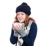 Winter woman enjoying hot drink Royalty Free Stock Photos