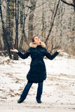 Winter woman in a forest Stock Photos