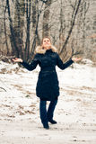 Winter woman in a forest Stock Photo