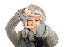 Winter woman framing her eyes royalty free stock photo