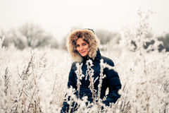 Winter woman in a frozen plant Stock Photos