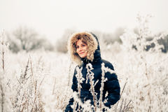 Winter woman in a frozen plant Stock Image