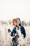 Winter woman in a frozen plant Royalty Free Stock Photo
