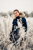 Winter woman in a frozen plant Stock Photography
