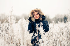 Winter woman in a frozen plant Royalty Free Stock Images