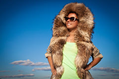 Winter Woman in Fur Coat. A photo of beautiful girl is in fur cl Royalty Free Stock Image