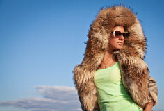Winter Woman in Fur Coat. A photo of beautiful girl is in fur cl Royalty Free Stock Photos
