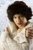 Winter woman with fur hat. Portrait of cute winter woman with white sweater and brown fur hat Stock Photography