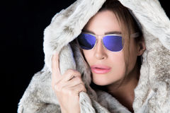Winter woman in fur hood and sunglasses Royalty Free Stock Images