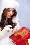 Winter woman with gifts. Stock Images