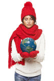Winter woman with globe Royalty Free Stock Photography