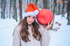 Winter woman happy. Winter portrait of young woman in the winter snowy scenery. What happens during winter season. royalty free stock photo