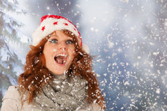 Winter woman with hat of Christmas Santa in snow Royalty Free Stock Image