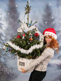 Winter woman with hat of Christmas Santa and tree Stock Image