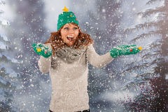 Winter woman with hat of Christmas tree and fun in the snow. Portrait of woman in winter with snow and hat and gloves of Christmas tree in snowstorm Stock Photography