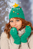 Winter woman with hat of Christmas tree Stock Images