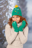 Winter woman with hat of Christmas tree Royalty Free Stock Photo