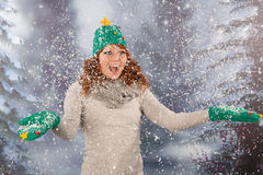 Winter woman with hat of Christmas tree in snowstorm Royalty Free Stock Photo