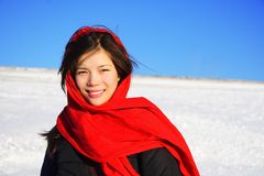 Winter woman with headscarf. Beautiful winter woman with red headscarf Stock Image