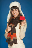 Winter woman holding credit card Royalty Free Stock Images