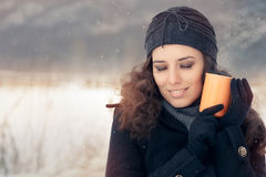Winter Woman Holding a Hot Drink Mug Royalty Free Stock Photo