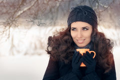 Winter Woman Holding a Hot Drink Mug Royalty Free Stock Image