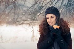 Winter Woman Holding a Hot Drink Mug Royalty Free Stock Images