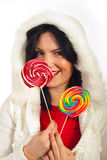 Winter woman holding lollipops Stock Photo