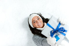 Winter: Woman Holding Up Holiday Gift Stock Photo
